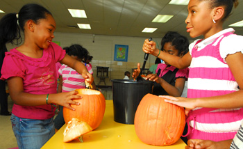 ASAP students at Peabody Elementary carve pumpkins as part of their Lights On After School activities.