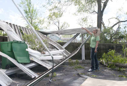 Jitterbugs Development Center co-owner Jennifer Ross inspects damage to her childcare center after storms tore into the area on April 22.